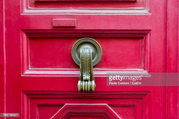 full frame shot of red door - door knocker stock photos and pictures