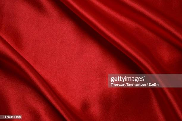 full frame shot of red fabric - silk stock pictures, royalty-free photos & images