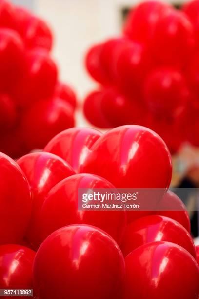 Full Frame Shot Of Red Helium Balloons Against Ceiling