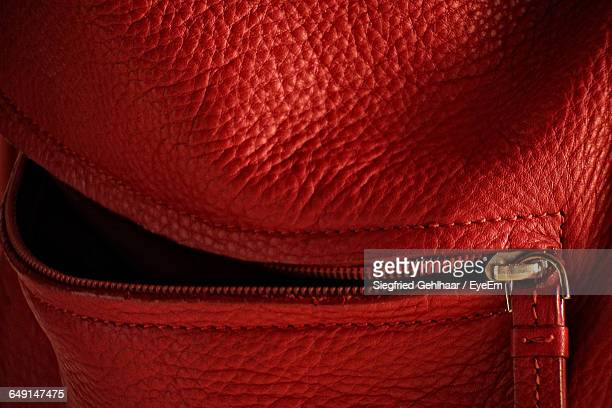 full frame shot of red leather purse - leather purse stock pictures, royalty-free photos & images