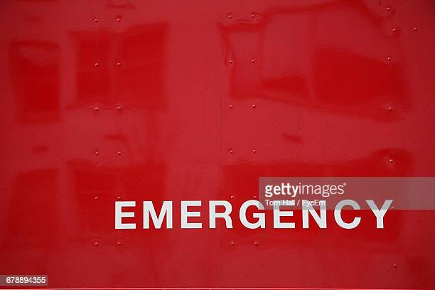 full frame shot of red metal with emergency sign - single word stock pictures, royalty-free photos & images