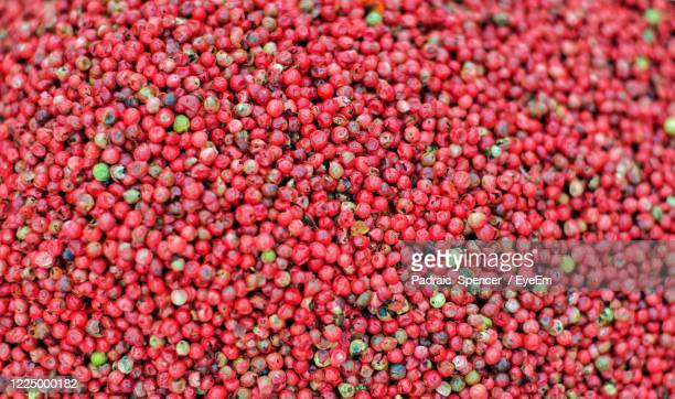 full frame shot of red peppercorns - abundance stock pictures, royalty-free photos & images