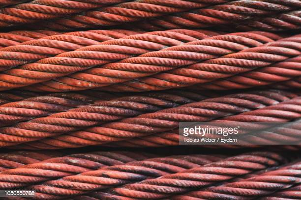 full frame shot of red rope - seil stock-fotos und bilder