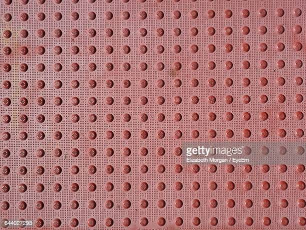 Full Frame Shot Of Red Rubber Mat