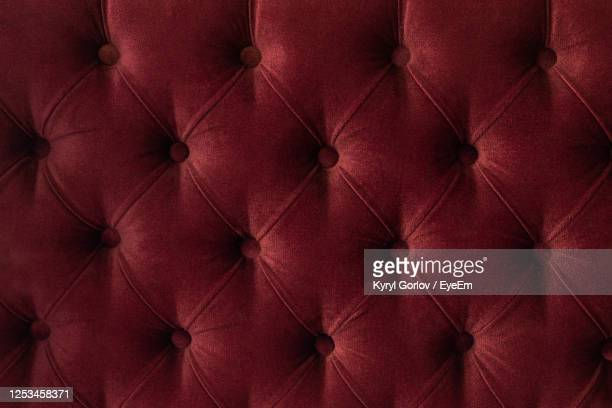 full frame shot of red sofa - velvet stock pictures, royalty-free photos & images