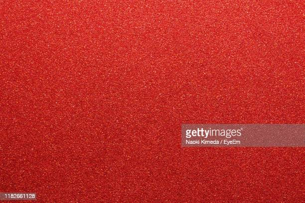 full frame shot of red textile - rood stockfoto's en -beelden