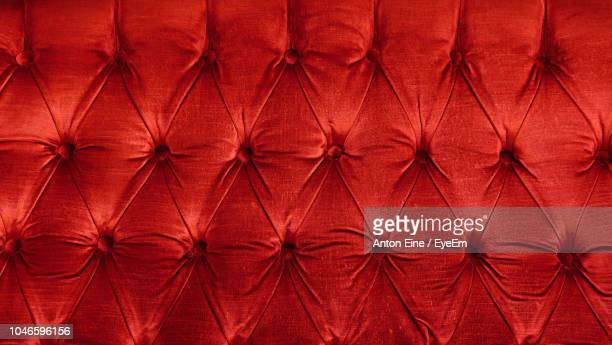 full frame shot of red velvet sofa - velvet stock photos and pictures