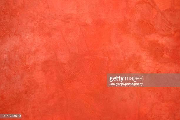 full frame shot of red wall - 化粧しっくい ストックフォトと画像