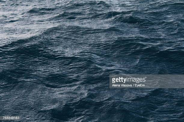 full frame shot of rippled water - dark blue stock pictures, royalty-free photos & images