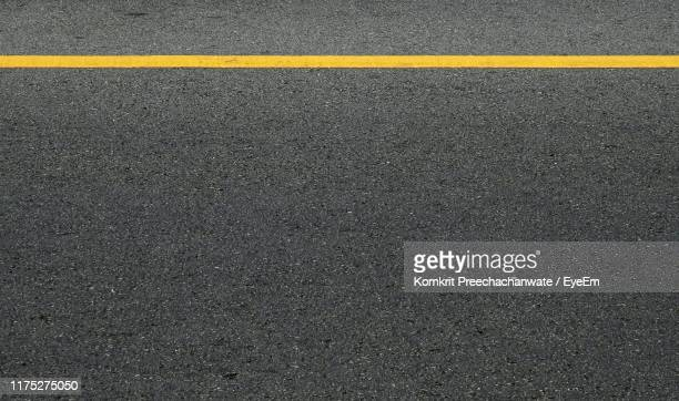 full frame shot of road - dividing line road marking stock pictures, royalty-free photos & images