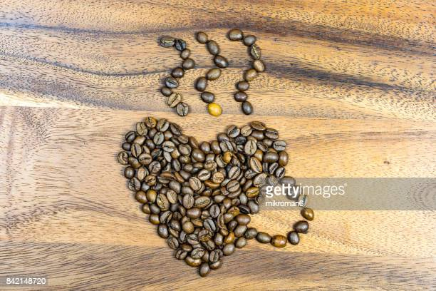 Full Frame Shot Of Roasted Coffee Beans. Close-Up Of Coffee Beans, Heart Shape