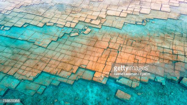 full frame shot of rocks in water - geology stock pictures, royalty-free photos & images