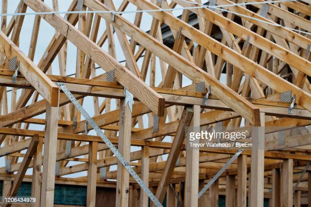 full frame shot of roof construction - lara rafter stock pictures, royalty-free photos & images