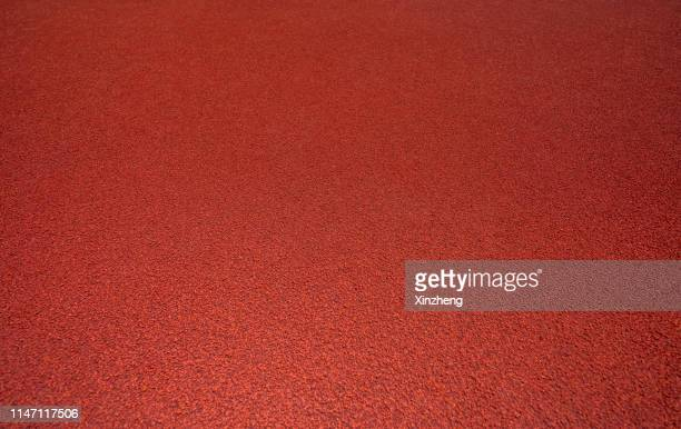 full frame shot of running track - running track stock pictures, royalty-free photos & images