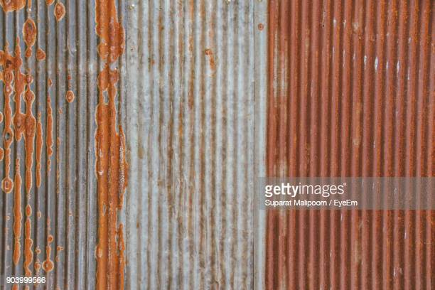 full frame shot of rusty corrugated iron - corrugated iron stock photos and pictures