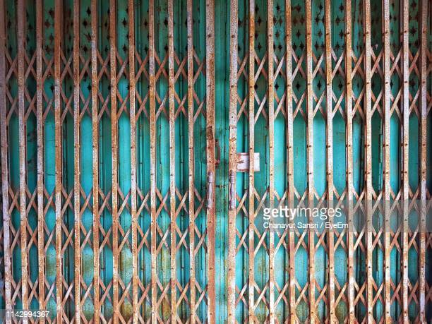 full frame shot of rusty metallic gate - chanayut stock photos and pictures