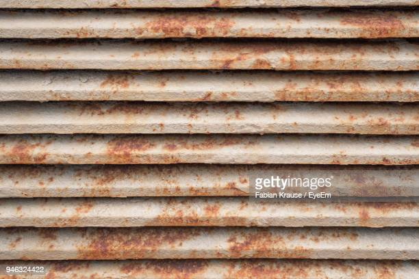 full frame shot of rusty shutter - rust colored stock photos and pictures