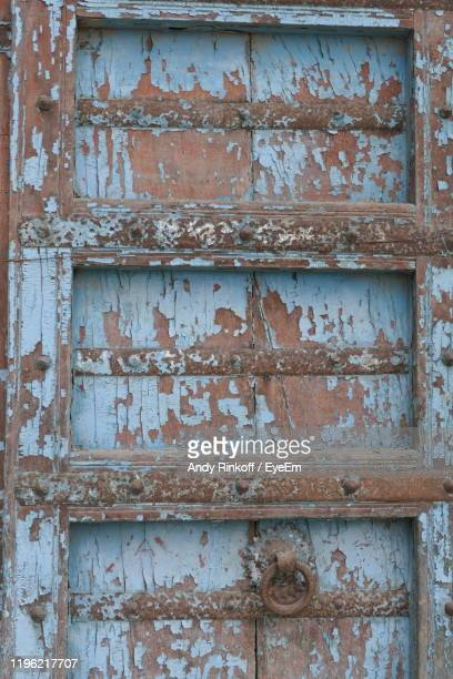 full frame shot of rusty wooden door - andy rinkoff stock pictures, royalty-free photos & images