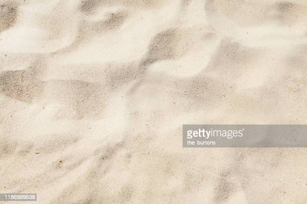 full frame shot of sand area on the beach - arena fotografías e imágenes de stock