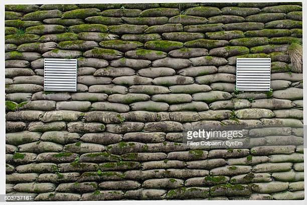full frame shot of sandbags stack - sandbag stock pictures, royalty-free photos & images