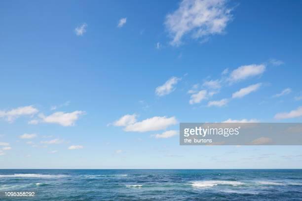 full frame shot of sea, clouds and blue sky, backgrounds - bleu photos et images de collection