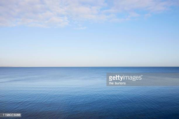 full frame shot of sea, clouds and clear sky, abstract blue background - schleswig holstein stock pictures, royalty-free photos & images
