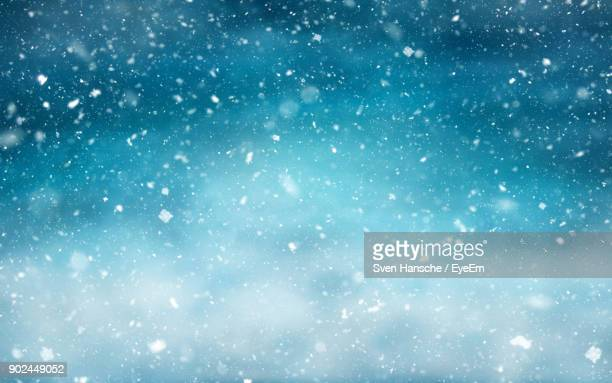 full frame shot of snowfall - winter weather stock photos and pictures