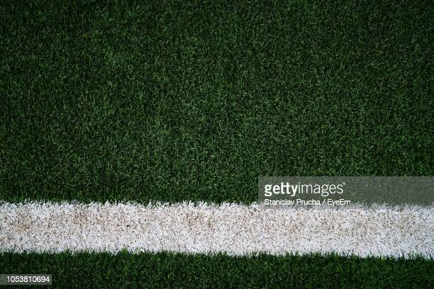 full frame shot of soccer field - turf stock pictures, royalty-free photos & images
