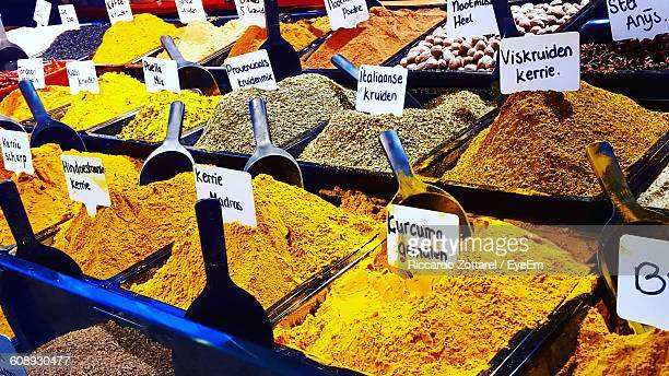 Full Frame Shot Of Spices In Containers With Label At Market Stall