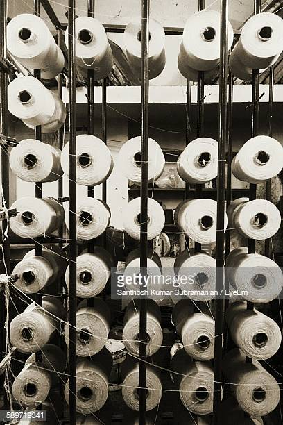 Full Frame Shot Of Spools In Textile Factory