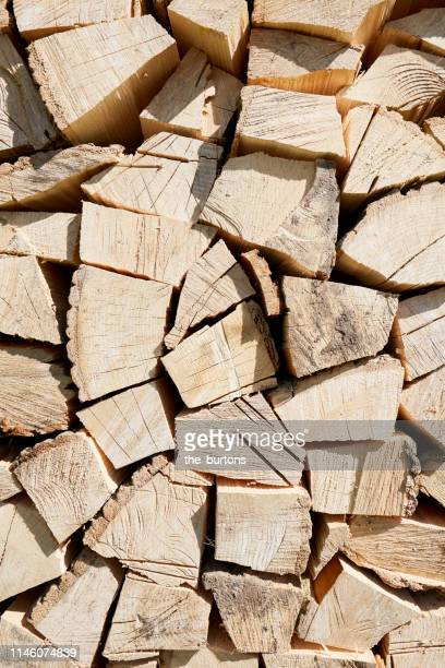 full frame shot of stack of logs (firewood) - firewood stock pictures, royalty-free photos & images