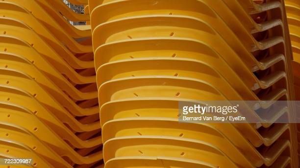 Full Frame Shot Of Stacked Chairs