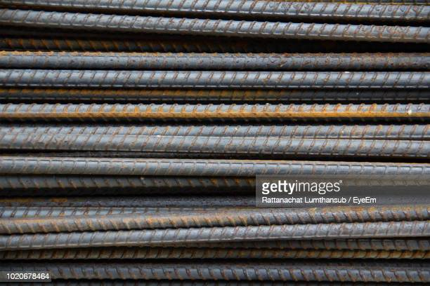 Full Frame Shot Of Stacked Metal Rods At Construction Site