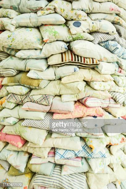 full frame shot of stacked pillows - pillow stock pictures, royalty-free photos & images