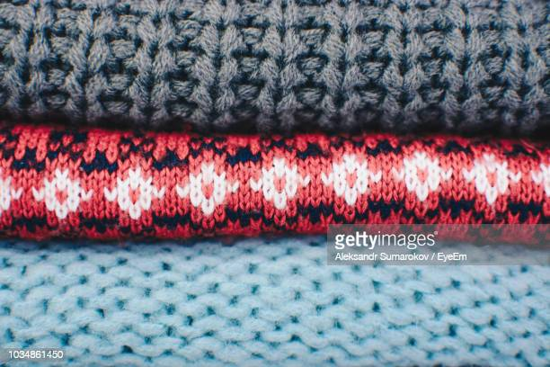 full frame shot of stacked sweaters - knitted stock pictures, royalty-free photos & images