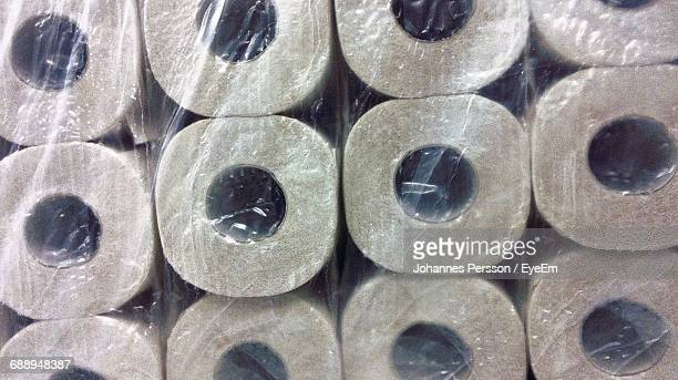 Full Frame Shot Of Stacked Toilet Papers In Plastic