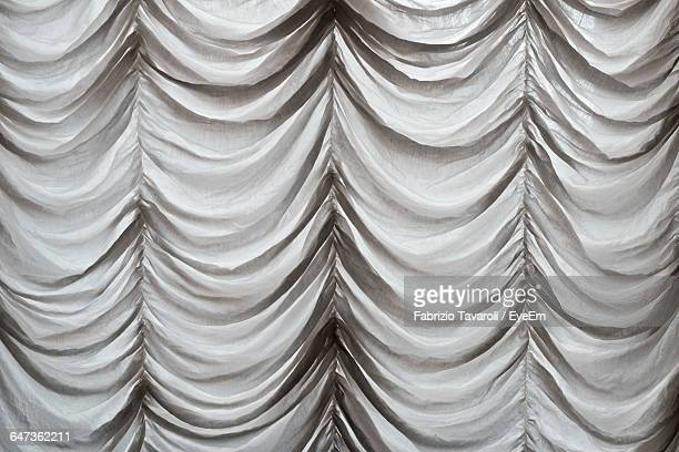 full frame shot of stage curtain - stage curtain stock pictures, royalty-free photos & images