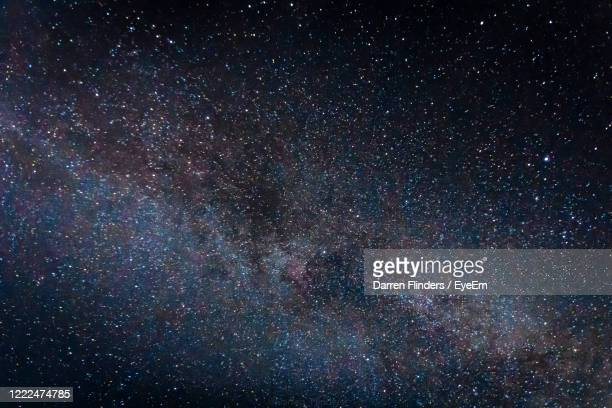 full frame shot of star field - heaven stock pictures, royalty-free photos & images