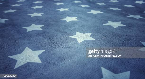 full frame shot of star shapes on american flag - patriotic stock pictures, royalty-free photos & images