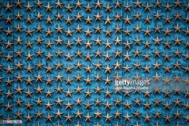 full frame shot of star shapes on wall - war memorial stock pictures, royalty-free photos & images