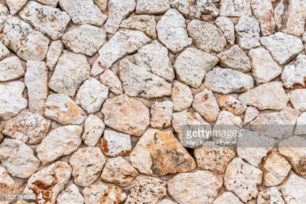 full frame shot of stone wall - manacor stock pictures, royalty-free photos & images