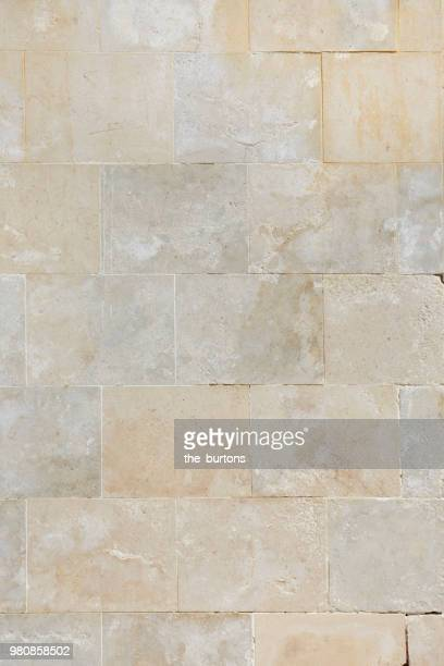 full frame shot of stone wall - stone wall stock pictures, royalty-free photos & images
