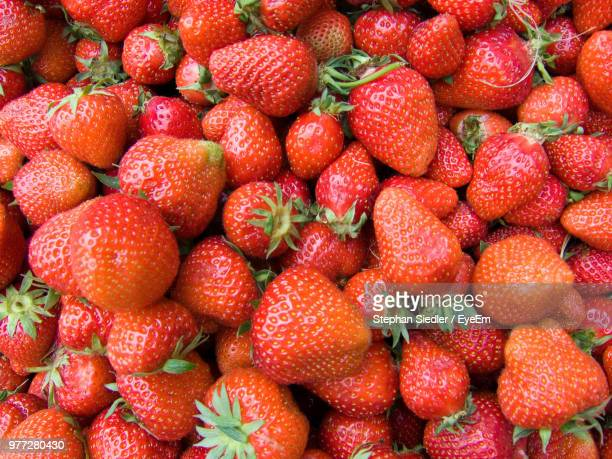 full frame shot of strawberries at market - abundance stock pictures, royalty-free photos & images
