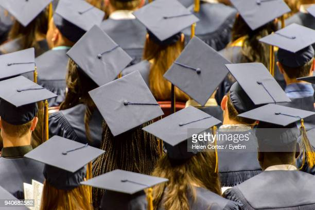 full frame shot of students during convocation ceremony - university stock pictures, royalty-free photos & images