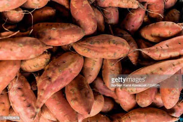full frame shot of sweet potatoes for sale at market - sweet potato stock pictures, royalty-free photos & images