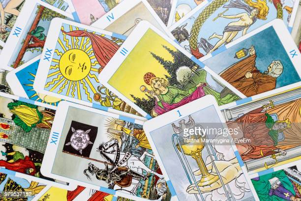 full frame shot of tarot cards - fate stock photos and pictures