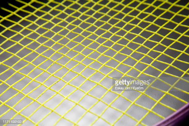 full frame shot of tennis racket against gray background - tennis racquet stock pictures, royalty-free photos & images