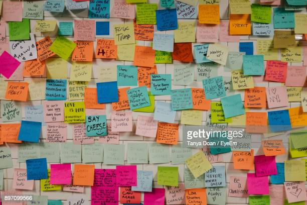 full frame shot of text on colorful adhesive notes - adhesive note stock pictures, royalty-free photos & images