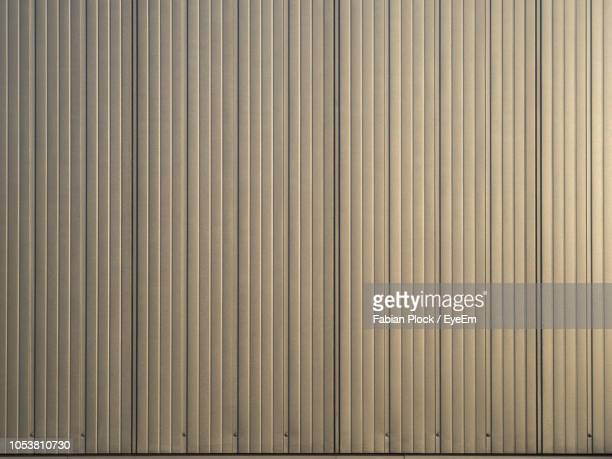 full frame shot of textured metal wall - corrugated iron stock photos and pictures