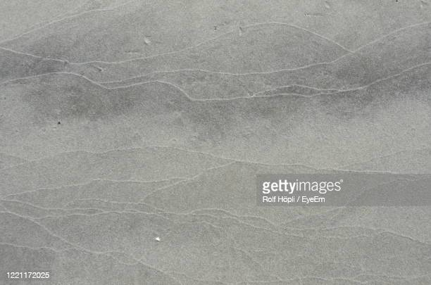 full frame shot of textured surface on sandy beach in denmark - ticket stock pictures, royalty-free photos & images